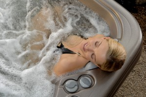 Beautiful-Woman-Relaxing-in-Hot-Tub-300x199